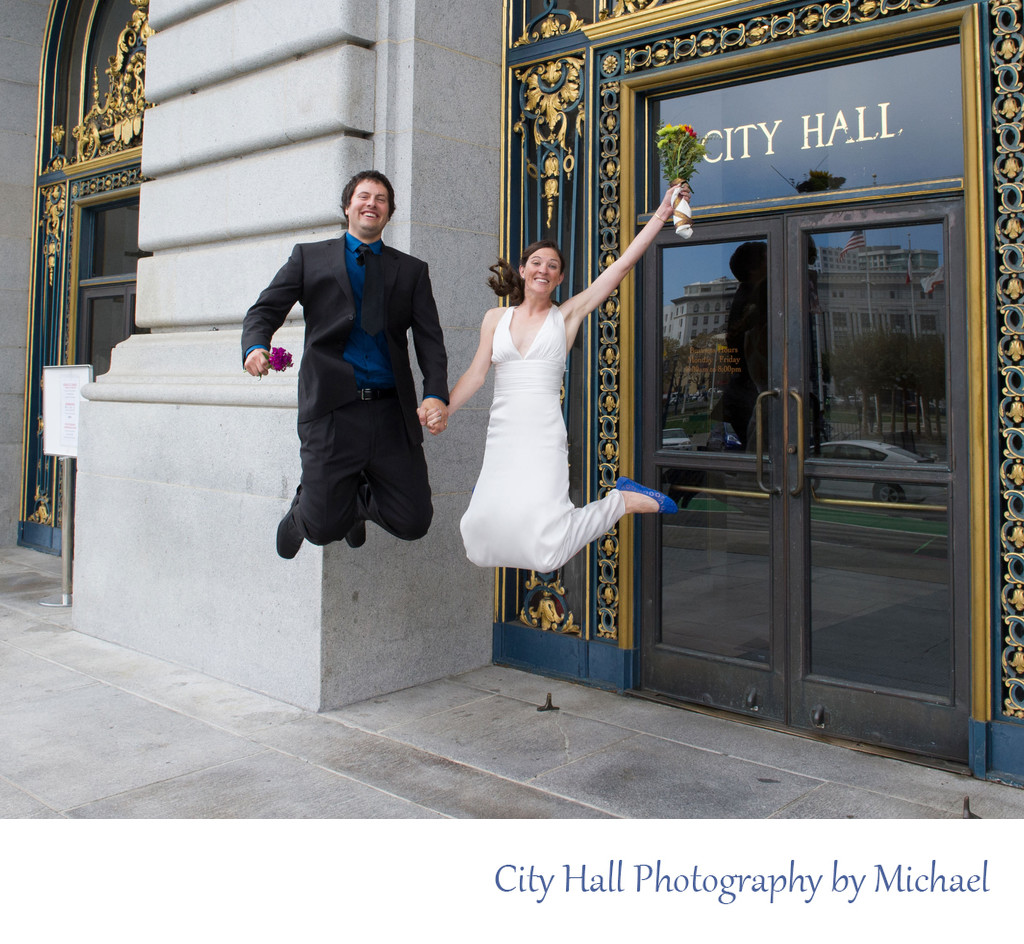 Jumping Married Couple Happy To have Completed Ceremony