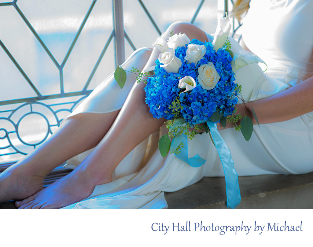 City Hall Window with Bride's dress and Floral Bouquet