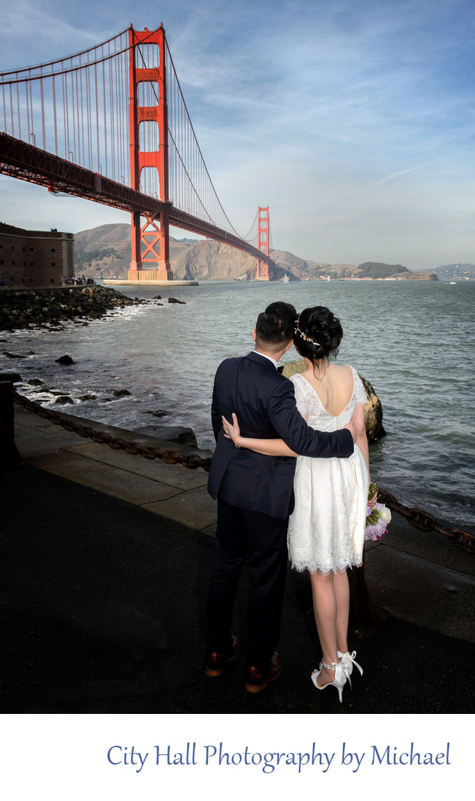 Bride and Groom looking at the Golden Gate Bridge in San Francisco