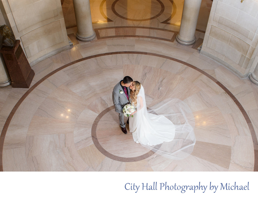 Newly Married Bride and Groom kissing in the Rotunda at City Hall