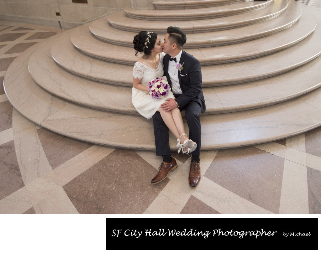 City Hall Grand Staircase kiss - San Francisco Wedding Photographer