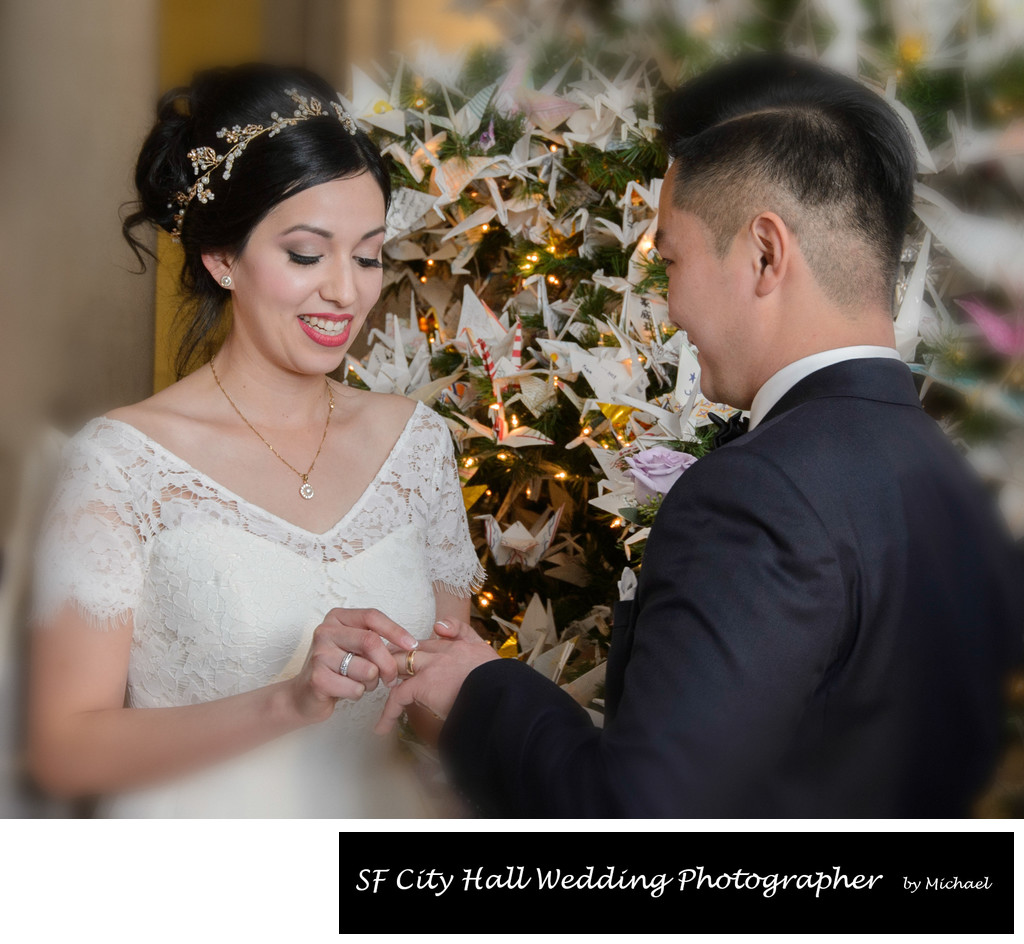 Bride and Groom Exchanging Rings during their Christmas Nuptials