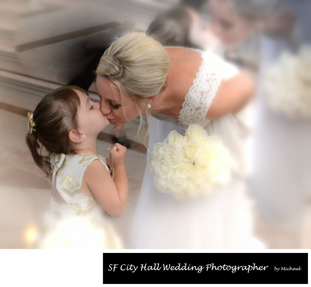Bride Kissing her Flower Girl Moments before Wedding Ceremony