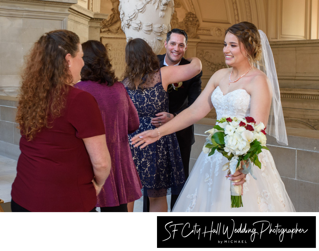 Guests Congratulating Newlywed Bride and Groom at SF City Hall