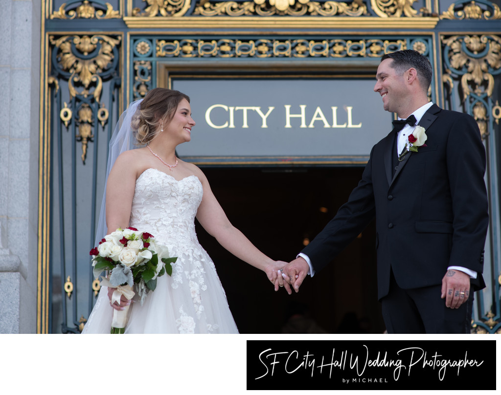 Newlyweds Leaving San Francisco City Hall by Entrance Sign