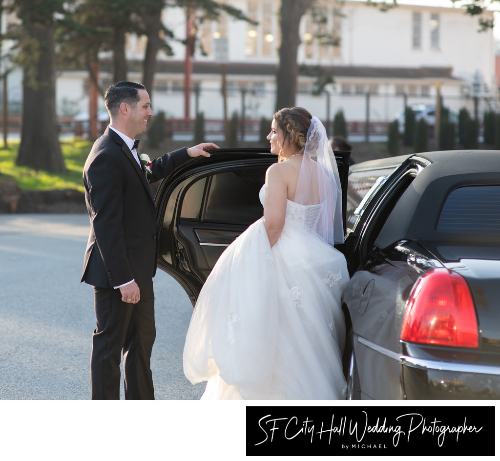Groom helps his Bride into the Limousine at the Palace of Fine Arts.