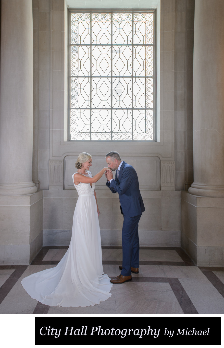 Hand kiss during wedding photography at city hall