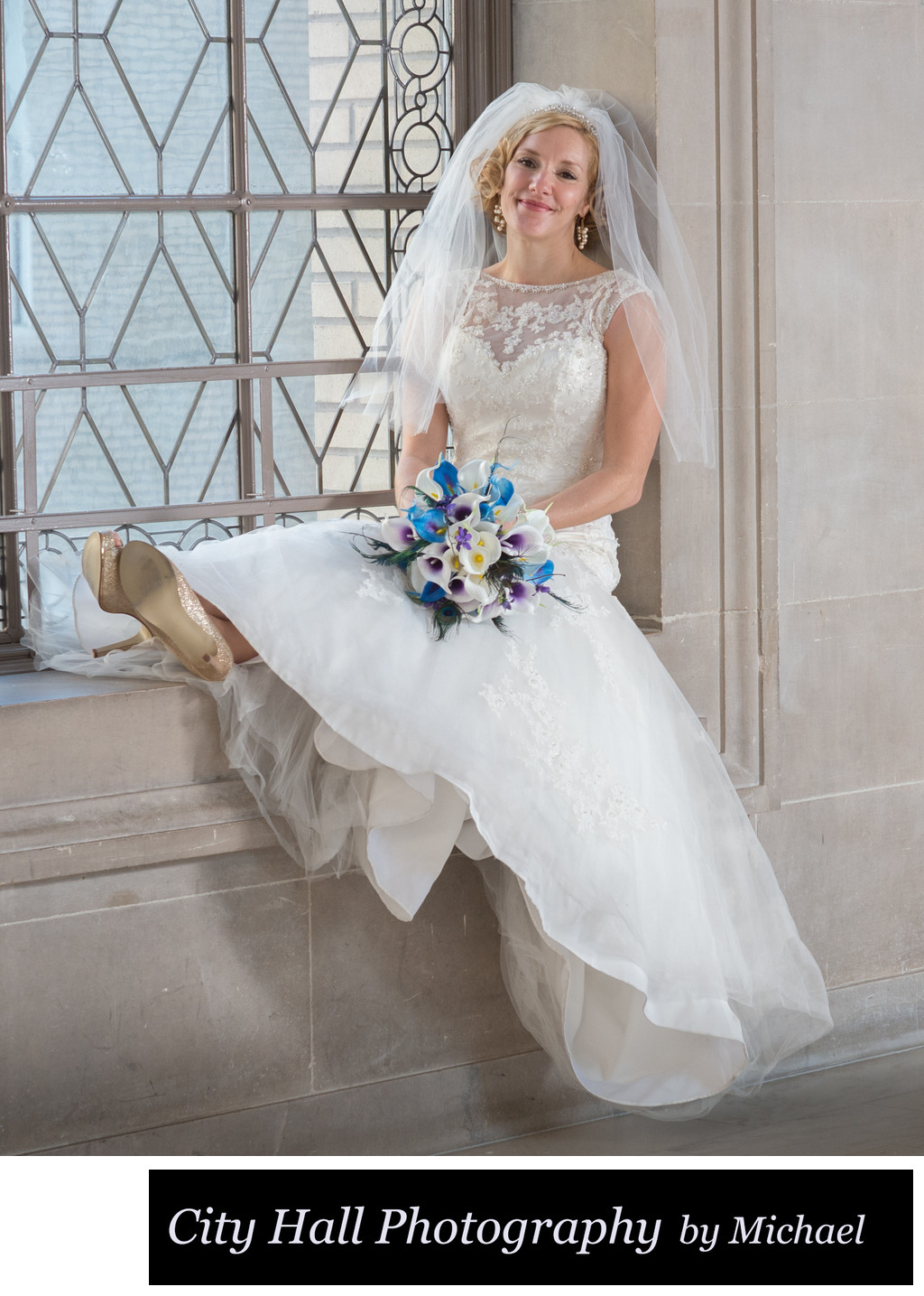 Cute Bridal Portrait Sitting on a City Hall window
