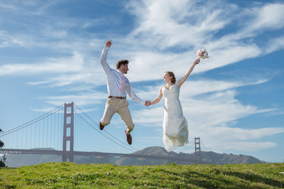 Bride groom jumping in San Francisco