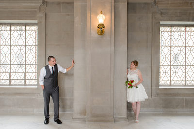 Dual windows peak around pose - City Hall Wedding Photographers