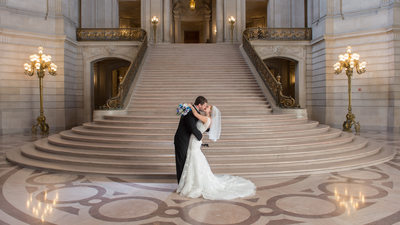 Grand staircase kiss with Professional Back Lighting