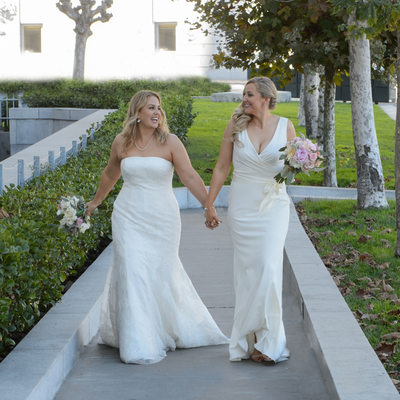 Lesbian wedding holding hands walking in San Francisco