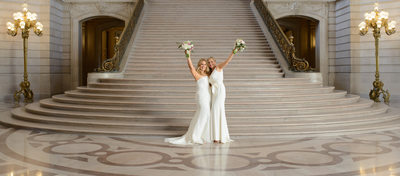 Same sex grand staircase wedding photography