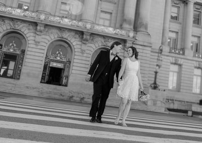Married Couple walks away from San Francisco City Hall Wedding