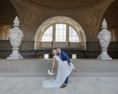 Groom Dance Dipping Bride with Kiss at SF City Hall