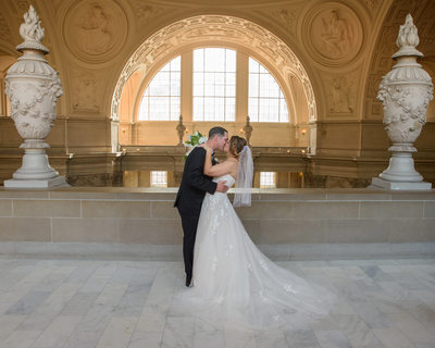 SF City Hall Bride and Groom Kiss on the 4th Floor North Gallery