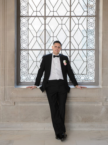 Portrait of Groom in Window - Wedding Photography Image
