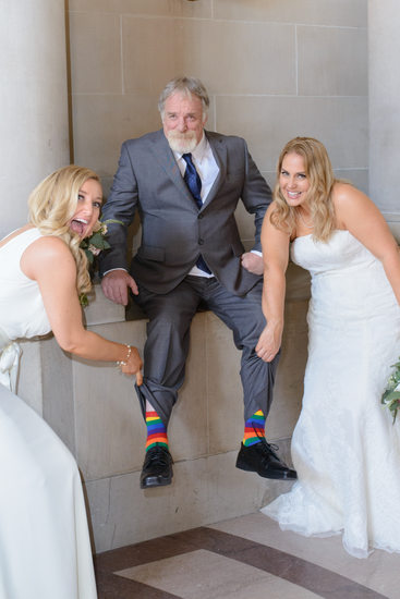 Dads rainbow socks in honor of daughter's gay nuptials