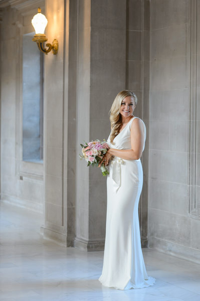 Blonde bridal portrait with bouquet at city hall