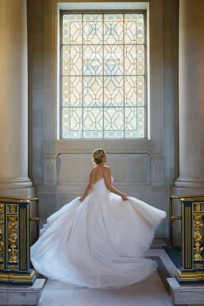 twirling bride in San Francisco at City Hall showing motion