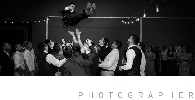 groom in the air at the reception