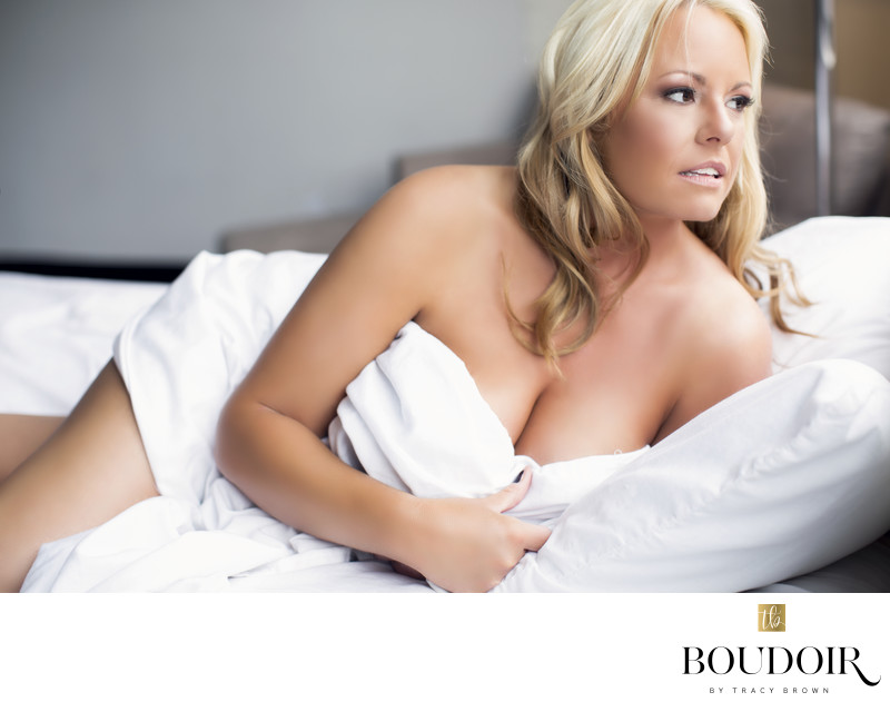 Impllied nude/White sheets/ blonde hair/ boudoir photo