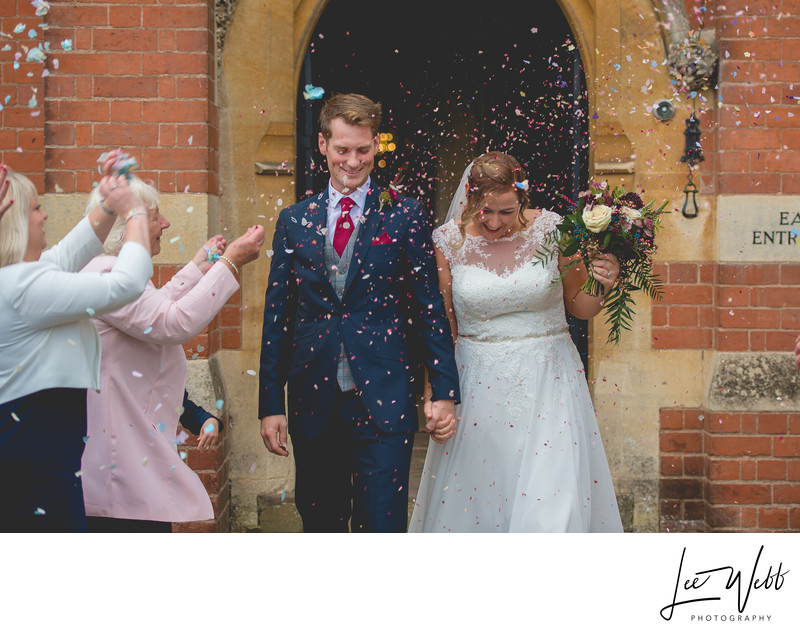Throwing Confetti Stanbrook Abbey Wedding Venue Worcester