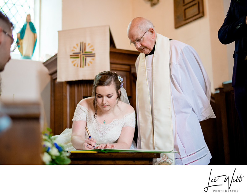 Signing Register in Church Photos