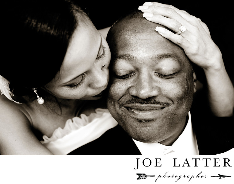 Beautiful black and white wedding image of African American man and his Asian bride.