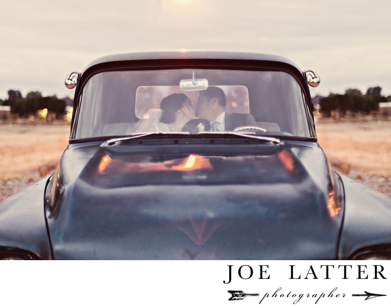 Old Pickup Truck Wedding Photograph with Bride and Groom