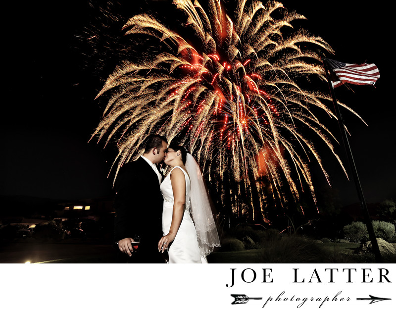 Amazing image of bride and groom kissing on Fourth 4thof July with fireworks at DragonRidge Golf Club in Henderson, Nevada.