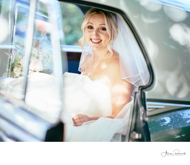 Bride in Car Derbyshire Wedding Photographer