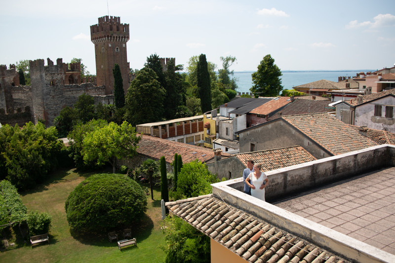 The bride and groom on the roof top in Lazise