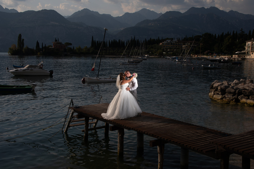 Bride & Groom on a jetty in Malcesine on Lake Garda