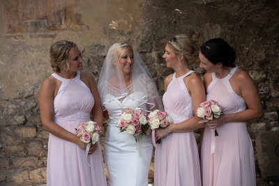 Bride & bridesmaids in Malcesine Castle walls