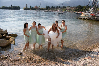 Bride & girls paddling in the Lake Garda in Malcesine
