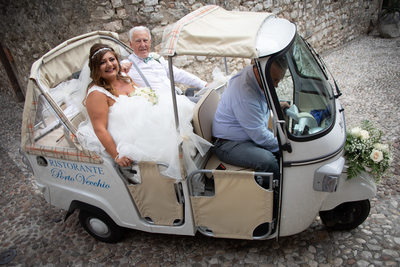 Bride & dad heading to Malcesine Castle on Lake Garda