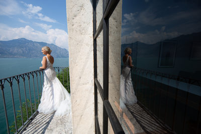 Bride admiring the view from Malcesine Castle
