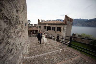 Bride and Her Dad arriving into Malcesine Castle