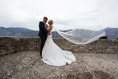Emma & Matt - windy day on top of Malcesine Castle