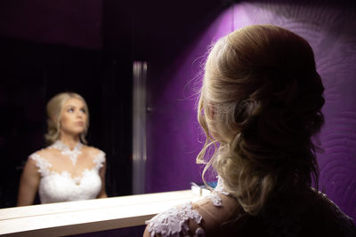 Bride in a purple bathroom