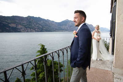 Handsome groom on Malcesine Castle Balcony.