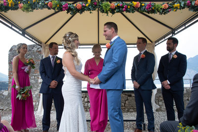 Meredith and Danny exchanging vows in Malcesine Castle