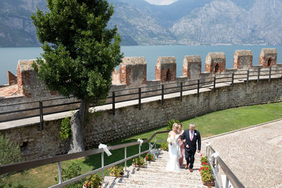 Claire and her dad up the steps in Malcesine Castle