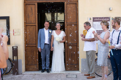 Bridal & Couple Leaving Lazise town hall.