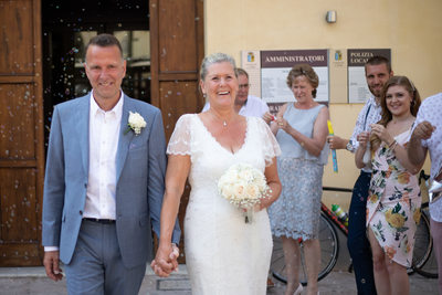 Bridal & Couple Leaving Lazise town hall happy bubbles