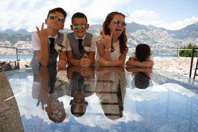 Reflections of lovely scoundrels in Malcesine Castle