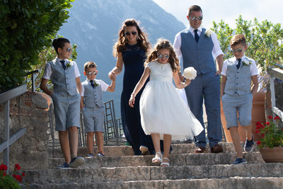 The perfect family walking down the stairs in Malcesine
