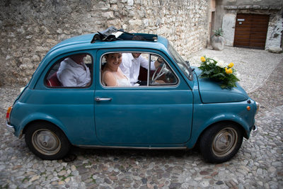 Blue fiat 500 in Italy.