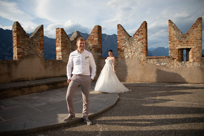 Fantastic light 5pm wedding Malcesine Castle, Italy